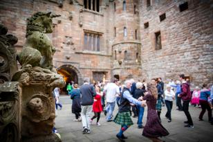 Group of dancers in forecourt at Linlithgow Palace
