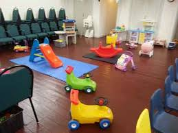 Picture of ride on toys in a room set up for children to play