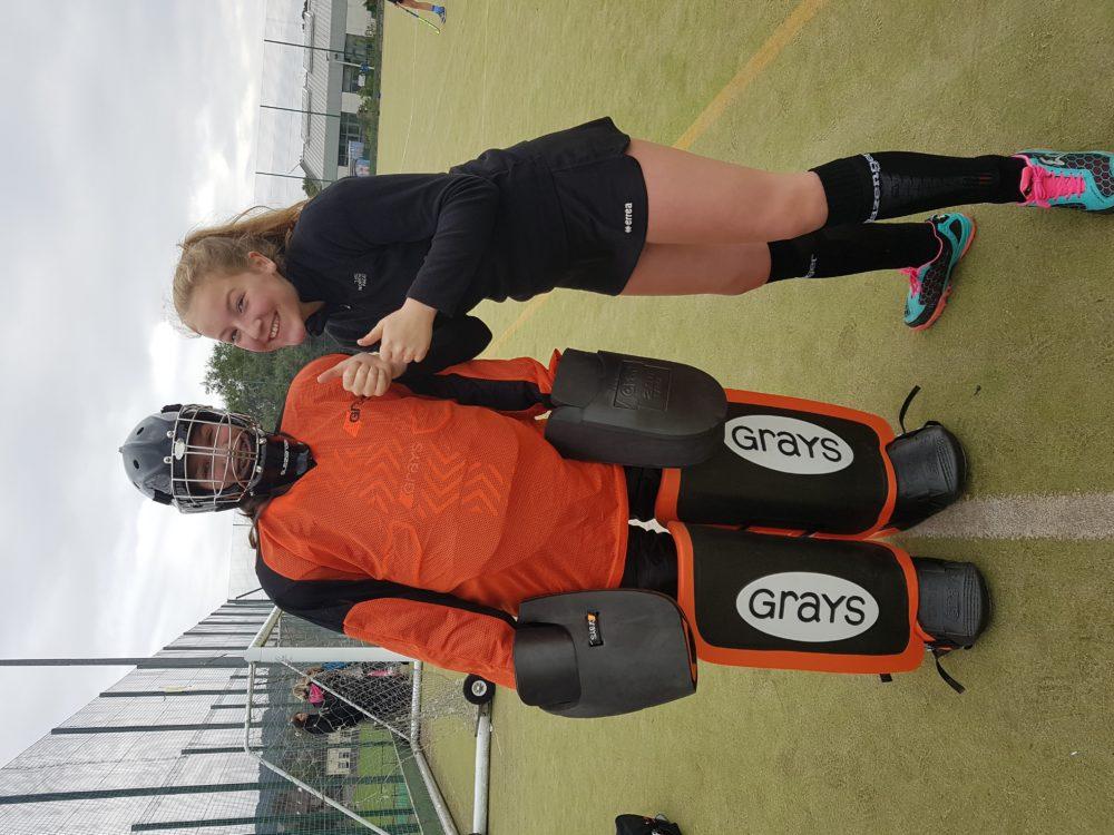 Hockey Goalie and Player