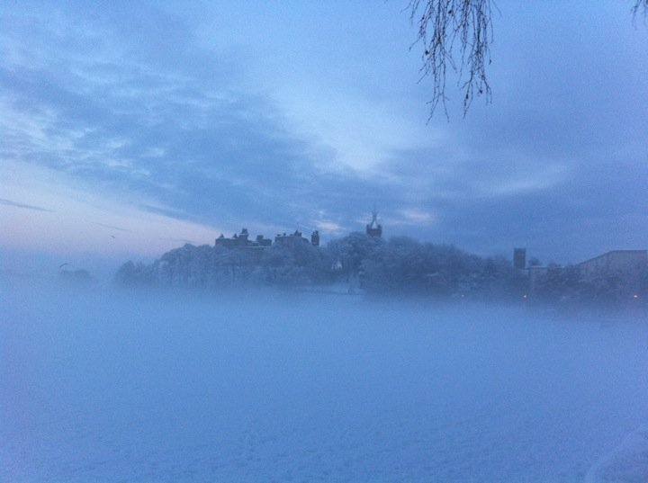 Linlithgow Palace through the fog by the Loch